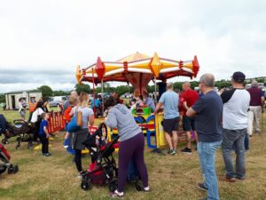 PHotograph of children enjoying a merry go round at Belgooly Agricultural show